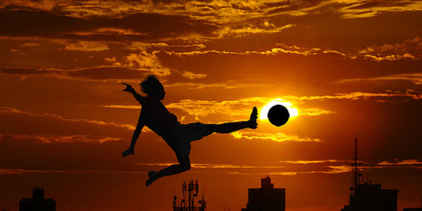Healthy Person Playing Soccer at Sunset